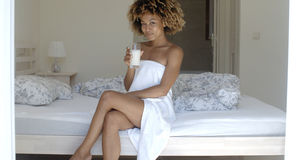 Pretty Girl Drinking Milk On The Bed Stock Photography