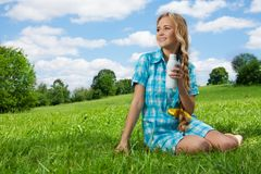 Pretty girl drinking yogurt Royalty Free Stock Photography