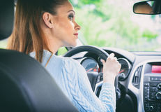 Pretty girl driving car Stock Photography