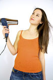 Pretty girl drying her hair Stock Images