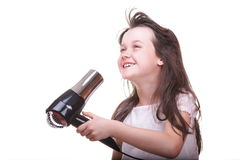 Child girl drying hair Royalty Free Stock Image