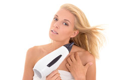 Pretty girl drying her hair with hairdryer Stock Images