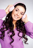 Pretty girl with earmuff Royalty Free Stock Images