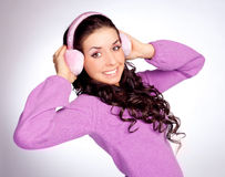 Pretty girl with earmuff Stock Photos