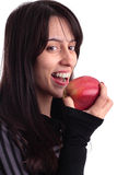 Pretty girl eating an apple Stock Image