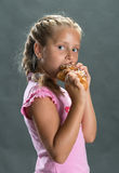 Pretty girl eating cookie Royalty Free Stock Images