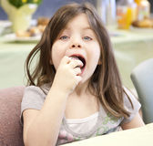 Pretty girl eating a donut Royalty Free Stock Photos