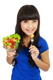 Pretty girl eating fruit salad Stock Photo