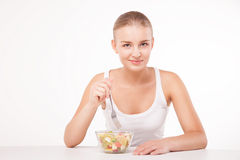 Pretty girl eating fruit salad isolated Stock Image