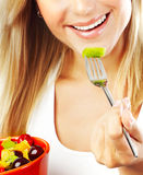 Pretty girl eating fruits Royalty Free Stock Image