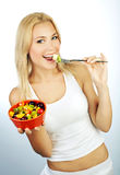 Pretty girl eating fruits Royalty Free Stock Photo