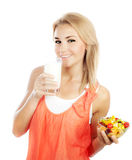 Pretty girl eating fruits and drinking milk Stock Images