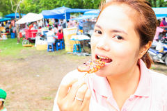 Pretty girl eating grilled pork and sticky rice in thailand Royalty Free Stock Images