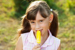 Pretty girl eating ice cream Stock Image