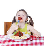 Pretty girl eating pasta and meatballs Stock Images