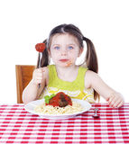 Pretty girl eating pasta and meatballs Stock Photo