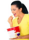 Pretty Girl Eating Popcorn. Close up shot of young woman eating popcorn royalty free stock photography