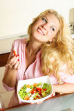Pretty girl eating salad Royalty Free Stock Photos