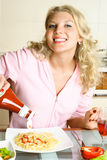 Pretty girl eating spaghetti Royalty Free Stock Photo