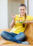 Pretty girl eating vegetables salad Stock Photography