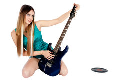 Pretty girl with electric guitar Stock Photos