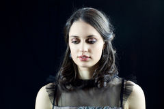 Pretty girl in elegant dress  looking down shyly Royalty Free Stock Images
