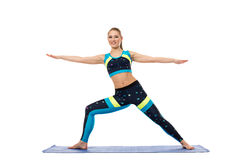 Pretty girl engaged in aerobics on mat Royalty Free Stock Image