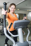 Pretty girl is engaged in the gym Royalty Free Stock Photo
