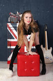 Pretty girl in English style music studio Royalty Free Stock Images