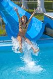 Pretty girl enjoy the water-park in summer Royalty Free Stock Photo
