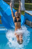 Pretty girl enjoy the water-park in summer Royalty Free Stock Photos