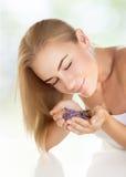 Pretty girl enjoying aromatherapy Royalty Free Stock Images