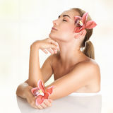 Pretty girl enjoying day spa. Pretty girl with closed eyes enjoying day spa, body care, healthy lifestyle, beauty treatment in a spa salon, relaxation during Stock Image