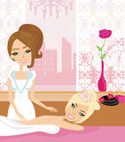 Pretty girl enjoying elegant spa. Relaxing massage Royalty Free Stock Photo