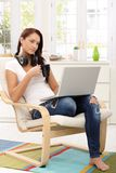 Pretty girl enjoying leisure time with laptop Royalty Free Stock Images