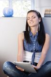 Pretty girl enjoying music eyes closed Stock Photos