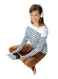 Pretty girl enjoying music on headphones Stock Photo