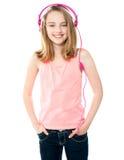 Pretty girl enjoying music through headphones Stock Photos
