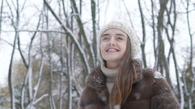 Pretty girl enjoying of snow falling. Slow motion stock video