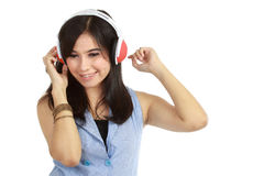 Pretty girl enjoys listening music Stock Photo