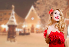 Pretty girl excited in dress on winter night urban Royalty Free Stock Images