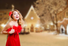Pretty girl excited in dress on winter night urban Royalty Free Stock Photography