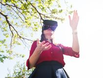 Pretty girl is experiencing something with virtual reality Royalty Free Stock Photo