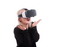 Pretty girl experiencing virtual reality through VR headset Stock Photography