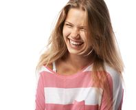 Pretty girl  expressively laughs. Pretty girl closing her eyes expressively laughs Stock Photo