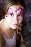 Pretty girl with face painting on black background Stock Photography