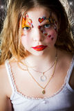 Pretty girl with face painting on black background Stock Photo