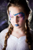 Pretty girl with face painting on black background. Pretty girl with face painting of sign of the zodiac Scorpio royalty free stock photo