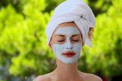 Pretty girl with facial mask Royalty Free Stock Photos