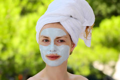 Pretty girl with facial mask Royalty Free Stock Image